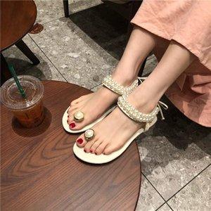 Yaz kadın sandalet moda elmas inci kelime toka kayış Kore düz alt vahşi rahat plaj ayakkabı özel