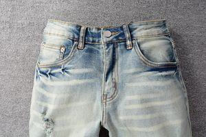 Мода мужская стройная нога джинсы качества тощий пух отверстия рваные джинсовые дизайнерская распылительная роспись зебры байкерские брюки
