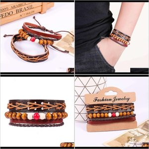Charm Bracelets Jewelry Drop Delivery 2021 Street Racket Leather Ethnic Wind Wooden Bead Multi Layer Braided Bracelet Set Amksy