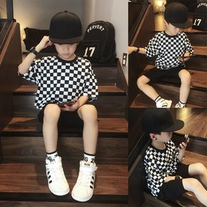 Girls' Boys summer short-sleeved T-shirt 2021 new big children's black and white checkerboard plaid Korean style loose hip-hop trend