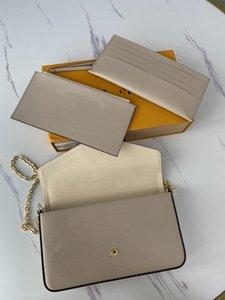 Carteras 61276 Cremallera 69977 bolsas de cadena de cuero astuto Moda Moda Tamaño genuino. 21cm * 12cm * 3cm