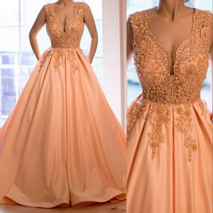 Sexy Peach Quinceanera Ball Gown Dresses V Neck Illusion Lace Appliques Crystal Beads Sweet 16 Dress Sweep Train Custom Party Prom Evening Gowns