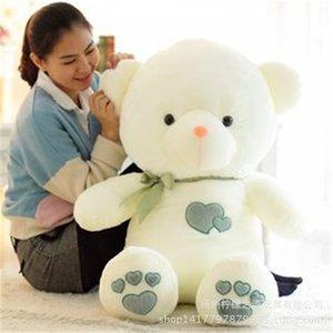 Muñecas Toy Teddy Bear Doll Sostiene el corazón de Bear's Heart.