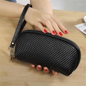Women Genuine Bag Cosmetic For 2021 Women Leather Actor makeup Clutch cell phone Bag leather Professional organizer Bags1