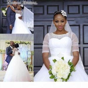 2020 South African Plus Size Wedding Dress Sheer Neck Beaded Bride Dresses Half Sleeves Dubai Bridal Gowns