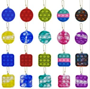 Amazon Fidget Simple Dimple Toy Keyring with a rainbow color square