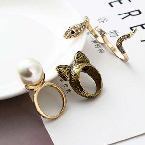 Diamond Inlaid Pearl Gold Cat ухо двойной палец змея геометрические мужские и женские полые сплавов кольцо