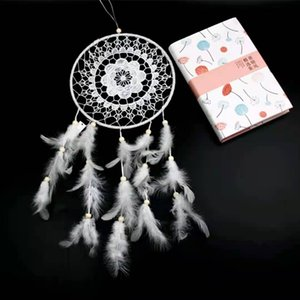 Young girl heart dream catcher Arts and Crafts students soft MOE room hanging feathers