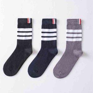 Medium length asymmetric calf pure cotton women's net red Korean version ins Fashion College wind pile socks absorb sweat and drain