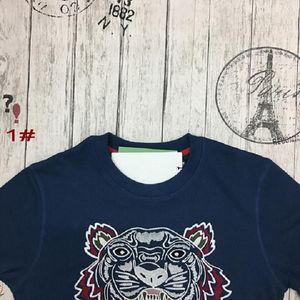Takai European American Tide Marca al por mayor polo camisa tigre cabeza bordado cuello redondo suéter hombres y mujeres con camiseta