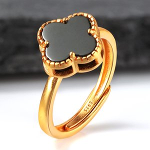 Spring Huanxin 925 silver inlaid Hetian ink jade ring four leaf grass mouth adjustable