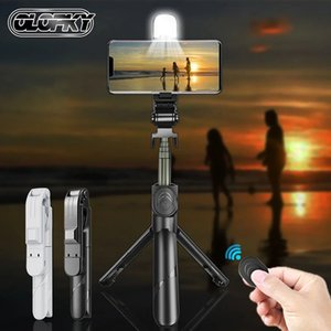The new designer's wireless selfie stick, Bluetooth-compatible foldable mini tripod and remote control with backlight are available on mobile, ios and Android