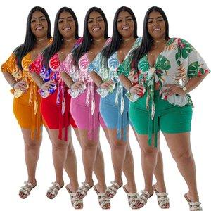 Plus Size Donne Donne Estate Tracksuits T-shirt Shorts 2 Pezzi Abiti L-4XL PAJAMA PAJAMA Vestito da jogger Lace Up Ruffle Manica corta Abiti Flora Stampato Abbigliamento asimmetrico 023