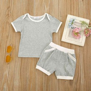 A new summer children's suit with two color pit bar splicing for boys and girlsGLDT