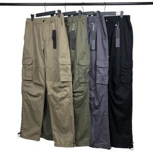 Мужские брюки высочайшего качества дизайнеры брюки значок пластыря буквы мужчин женщин женщины молнии дорожки трусьми хлопок вскользь грузовые брюки уличные нагрудника