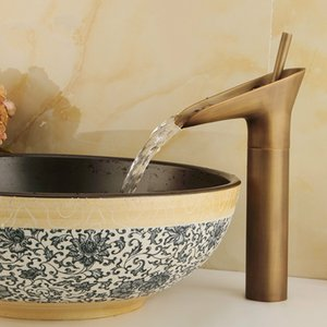 Wholesale and retail free shipping Copper basin faucet Bathroom faucet Single hole of cold faucet Retro style The ancient cup style