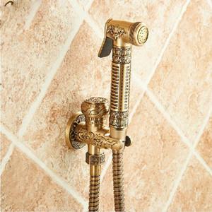 Venta al por mayor y al por menor de latón antiguo baño Bidet grifo flor tallada aseo limpieza mano ducha trapeador grifo grifo de latón macizo