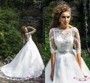 Прозрачные свадебные платья с высокой горловиной 2017 Спинка с длинными рукавами и бисером Аппликация Sash See Through Sweep Поезд Кружева Тюль Свадебные платья Арабский