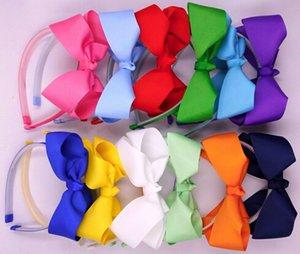 vendita calda 50PCS fascia in plastica con denti con boutique capelli arco bow headwear accessori per capelli per bambini