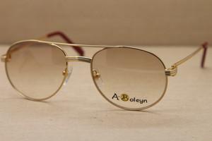 hombres libres del envío famoso 1191643 gafas de sol de las mujeres 2020 de metal Sun Glasses conducción al aire libre C Decoración gafas de marco de oro Tamaño: 56-20-135 mm