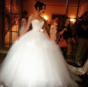 2019 Spring Beads Crystals Wedding Dresses Ball Gown Floor Length Bow Tulle Princess Romantic Bridal Gowns Lace up Back Custom Made
