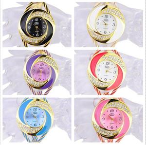 2015 Hot Rhinestone Diamond Whirlwind Design Metal Weave Dress Relojes de Pulsera Mujeres Niñas Señoras Pulsera Brazalete Relojes 7 colores