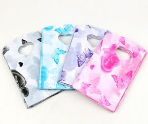 2017 새로운 200pcs / lot 4 색 15X9cm 심장 및 나비 패턴 플라스틱 보석 선물 가방 보석 파우치 가방