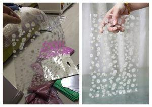 lote = 380pcs 9 * 12cm Flor de crisantemo bolsas de regalo transparentes bolsa de joyería pequeña al por mayor pequeña bolsa de plástico transparente