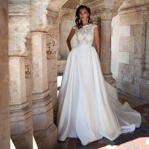 O col haut décolleté Sheer corsage en dentelle Top A-ligne de robe de mariée en satin dos nu avec poche robe de mariée robes de mariées