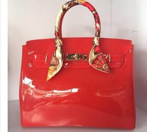 높은 품질의 고급 패션 여름 해변 가방 젤리 캔디 컬러 가방 여성 캐주얼 잠금 가방 지갑 bolsas 사무실 핸드백을 올려 놓