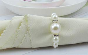 100pcs Blanc Table Serviette Hotel Fournitures Anneaux Pearls Mariage Accessoires Accessoires Décorations Lot par Jiuin