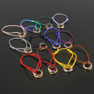 Venda quente de aço de titânio mão corda pulseira amor três anel de três cores para mulheres homens casal jóias por atacado de alta qualidade h pulseira