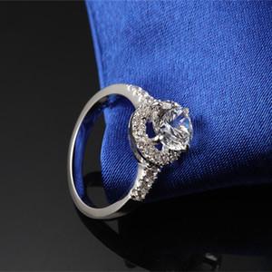 Testi Pozitif Marka Kalite Halkası 2CT Sentetik Ölümsüz Elmaslar Klasik Moissanite Halo Ring Gümüş Nişan Takı