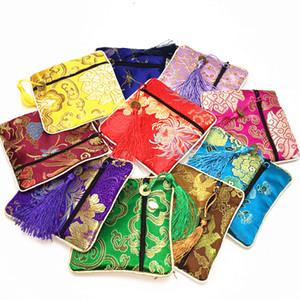 Haut de gamme petite fermeture à glissière porte-monnaie soie Brocade tissu bijoux cadeau sacs gland Bracelet stockage poche de mariage faveur 50pcs / lot