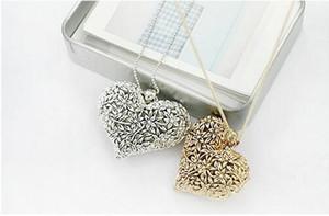 Retro hueco tallado flor suéter joyería collar joyería corazón amor suéter colgante cadena corazón forma colgante DHL regalo de Navidad
