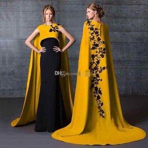 2019 Wunderschöne Saudi-Arabien Lange Abendkleider mit Flügelärmeln Schwarze Applikationen Meerjungfrau Satin Abendkleider Gold Celebrity Formal Dress