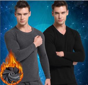 A roupa interior térmica dos homens novos do outono e do inverno mais o algodão redondo grosso do colar da caxemira no terno morno idoso