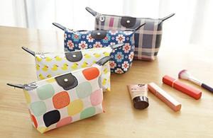 Bolsas de cosméticos Bolso de maquillaje Dumpling Mujer Nylon Maquillaje Bolsa de lavado Organizador bolsa