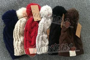 MOQ = 10 UNIDS Otoño / invierno marca diseño cálido sombrero mujer y hombre sombrero moda gorro de lana de punto 8 colores negro rojo envío gratis FÁBRICA BARATO