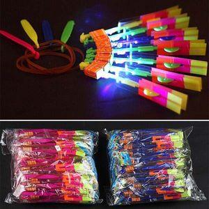 Los niños de iluminación LED Flying juguetes creativos para adultos de la novedad de la goma de la catapulta de la magia de flecha luminosa helicóptero juguetes de los niños los regalos de Navidad HH-T26