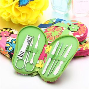 Venta al por mayor- Cartoon Flower Slipper Case Nail Tool Kit 7pcs / set Acero inoxidable Tijeras Manicura Herramientas de alta calidad 2926
