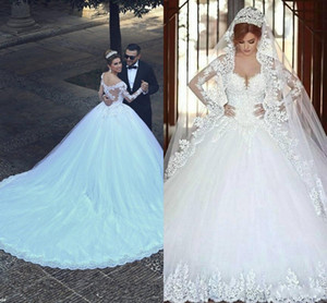 2020 Cheap Arabic Ball Gown Wedding Dresses Sweetheart Long Sleeves Lace Appliques Beads Long Open Back Court Train Plus Size Bridal Gowns