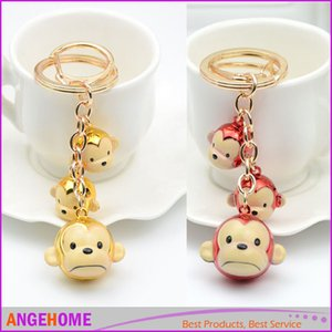 Art- und Weiseglocke-Affe Keychains kreative Karikatur-Affe-Beutel-reizend hängende Auto-Schlüsselring-Freund-Geschenke Freies Verschiffen