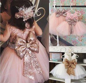 Новое прибытие розовый блесток платье девушки цветка с большим бантом Тюль платья девушки цветка для свадьбы