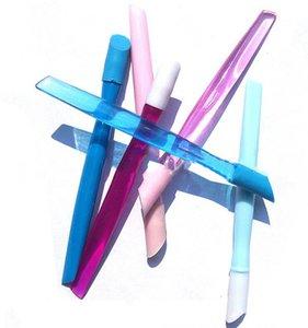 Nuevo 100pcs / lot 10 cm Cuticle Pusher Mix color transparente cuerpo con cabeza de goma suave Herramientas de uñas de alta calidad MJ001