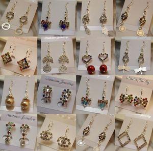 Mezcle la orden una variedad de pendientes Aretes de cristal redondos para las mujeres Arete de plata plateado la nueva moda CZ cuelgue los pendientes de la gota del diamante