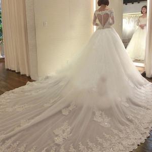 Великолепная иллюзия с длинным рукавом свадебное платье совок шеи бисером кружева аппликации Sheer в форме сердца обратно платье с длинным поездом свадебное платье