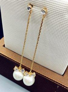Orecchini con borchie gioiello in joker con perle di bowknot delicate in edizione Han