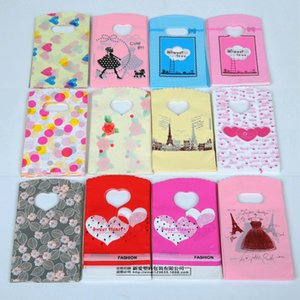 100pcs / lot 만화 플라스틱 포장 봉투 마음 귀여운 보석 선물 가방 의류 파우치 작은 중간 대형 포장 봉투