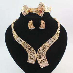 Conjuntos de joyas de oro / plateado Collar Llamativo Plateado Pulsera Anillo Pendiente Moda Cristal Hueco Tribal Novia Dama de honor Joyería de la boda